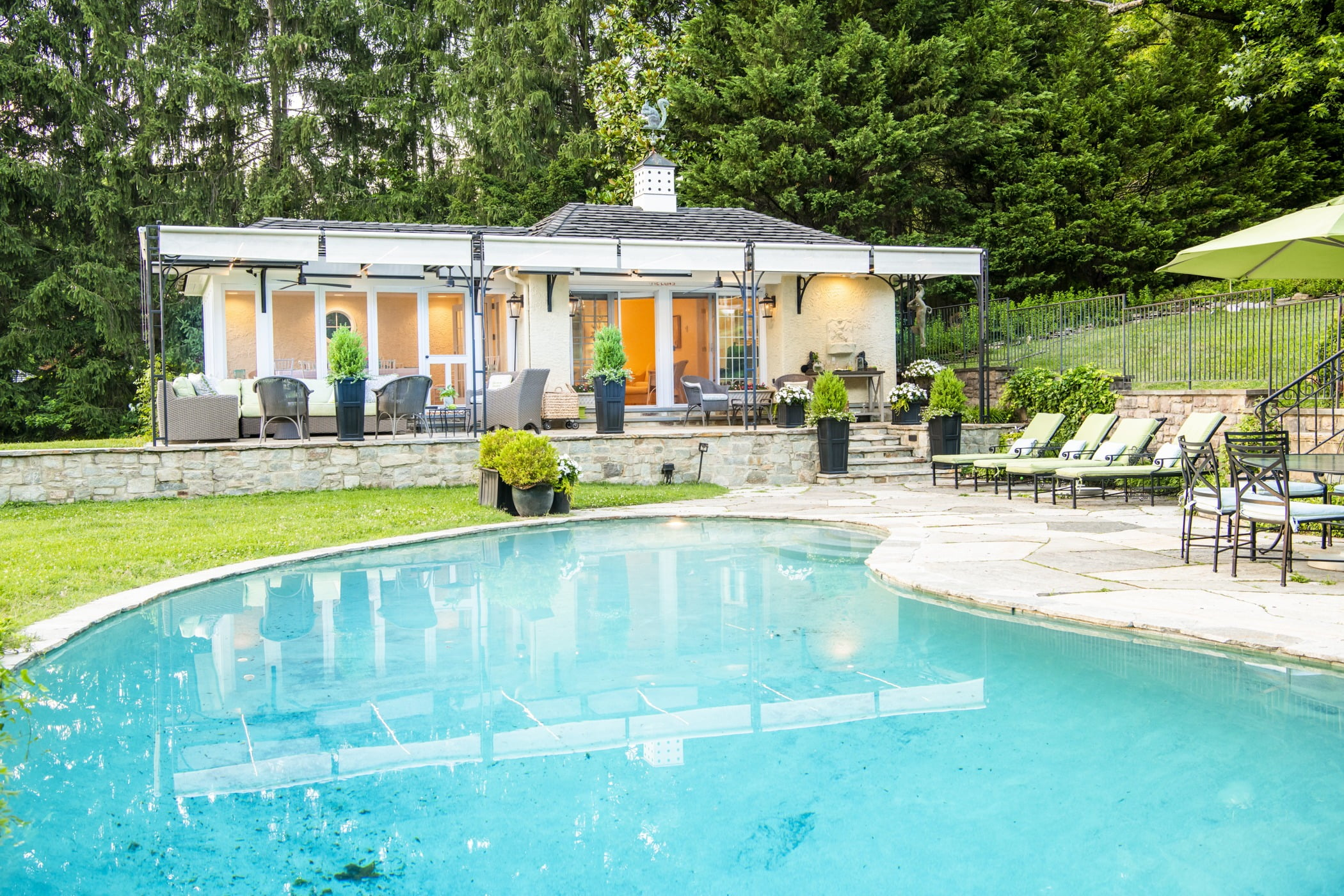Luxury pool house custom designed for a home remodel with a large seating space and large metal pergola (Pool view) (2)