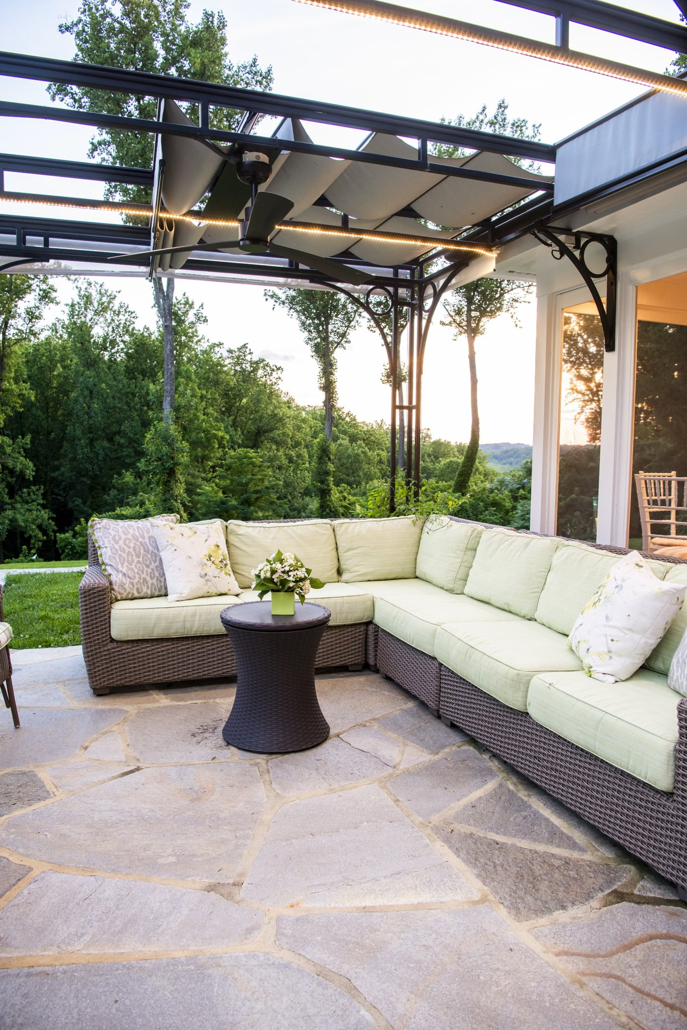 Luxury outdoor pool house space with an outdoor couch and retractable ceiling (3)
