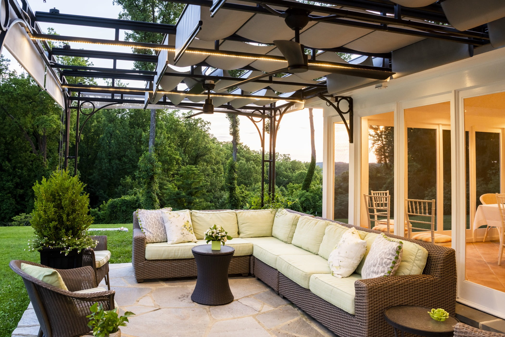 Luxury outdoor pool house space with an outdoor couch and retractable ceiling (2)
