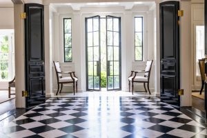Traditional foyer with black and white checkered tile flooring (Different view)