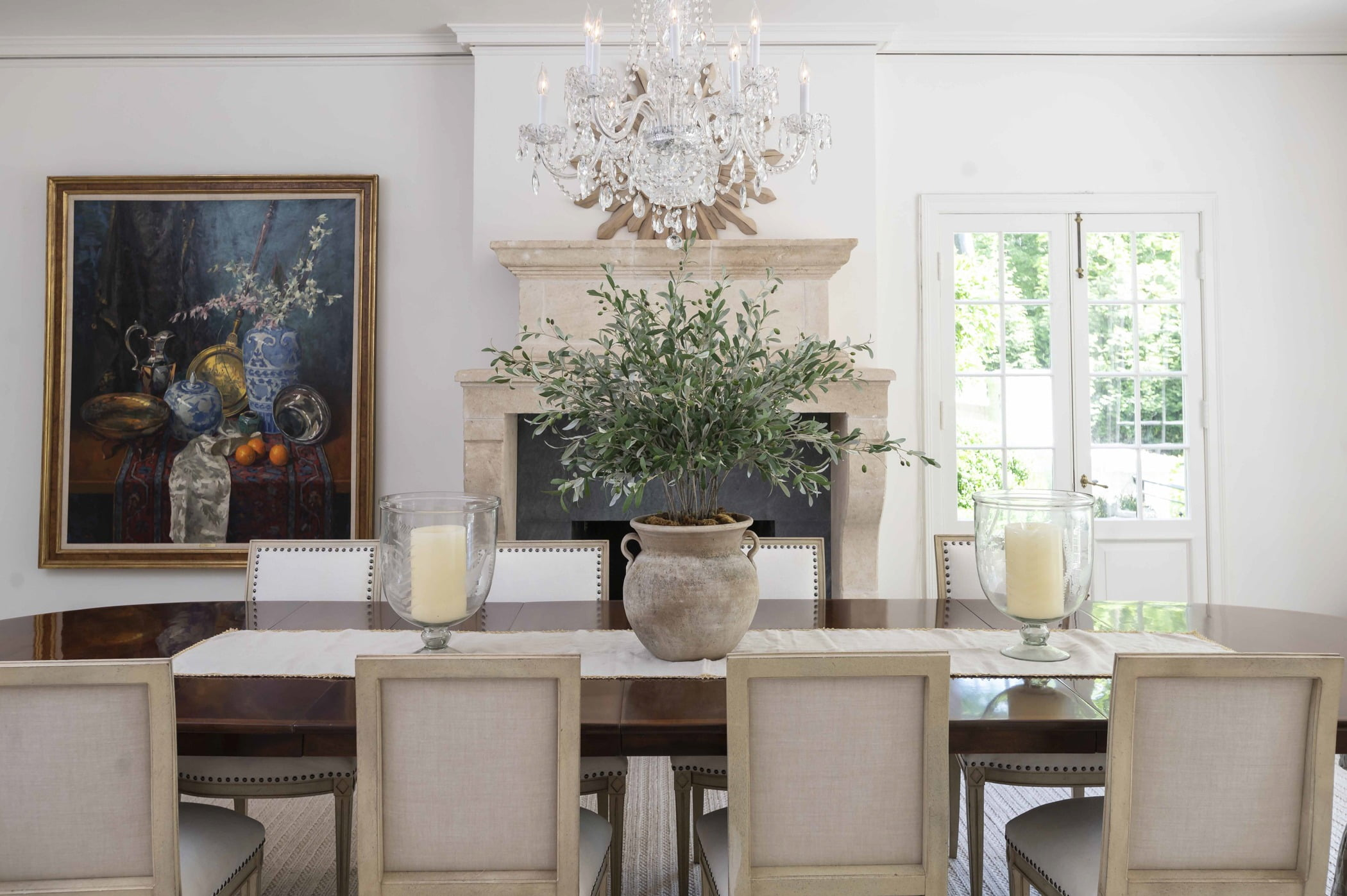 Traditional dining room table and crystal chandelier (Zoomed in)