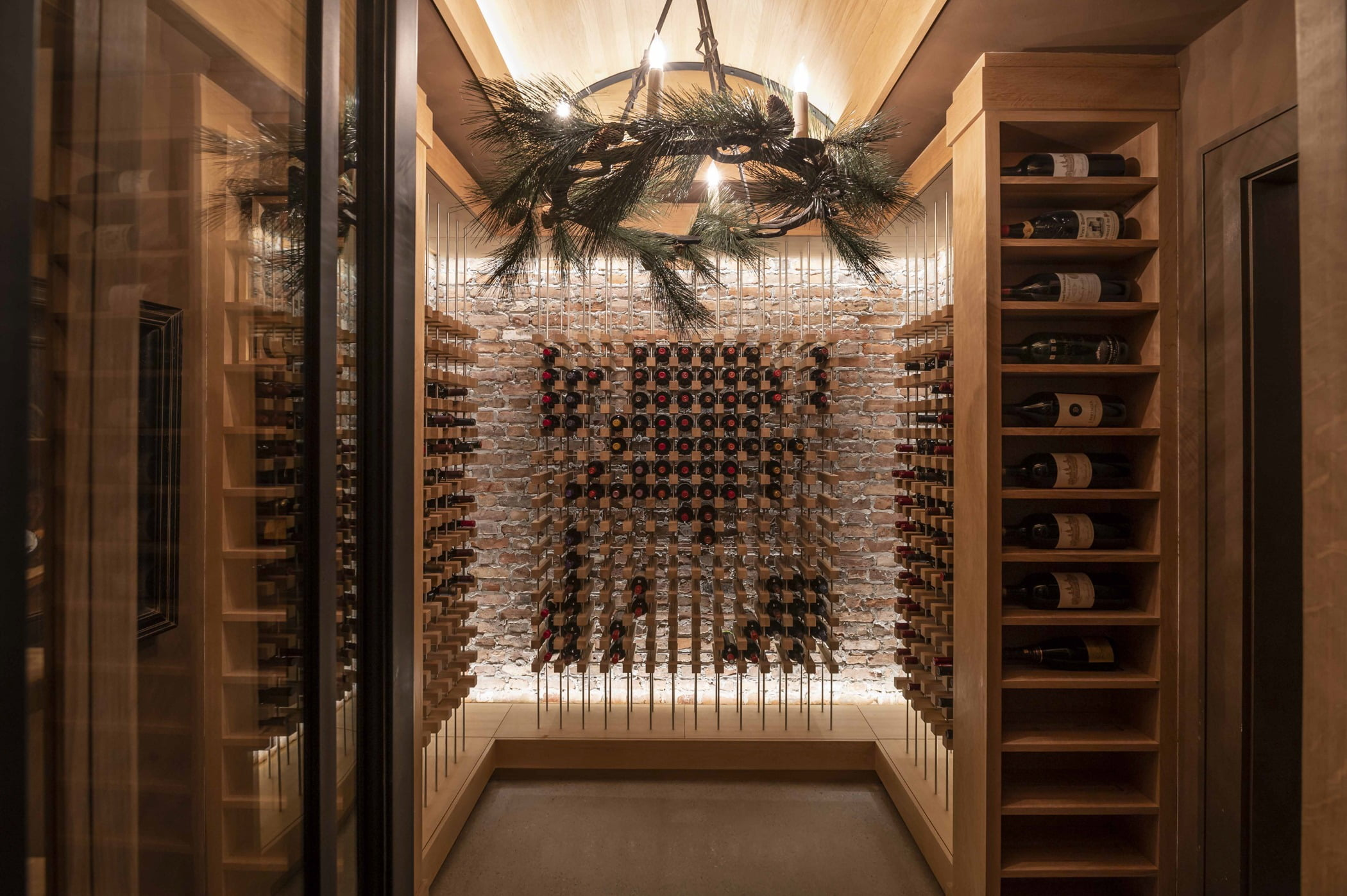 Custom wine cellar completed by Sunnyfields Cabinetry and Delbert Adams Construction Group (Different view)