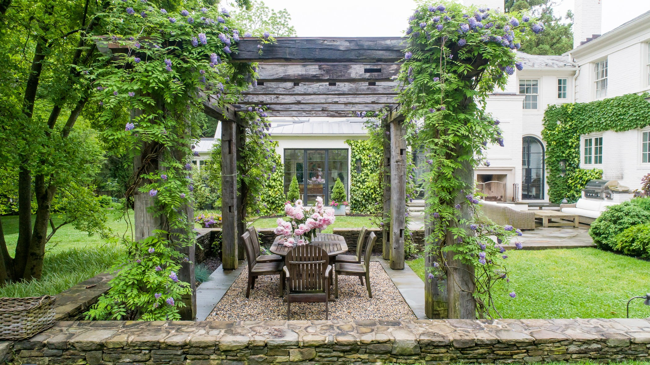 Ivy-covered wooden pergola, outdoor seating and dining area (Different view)