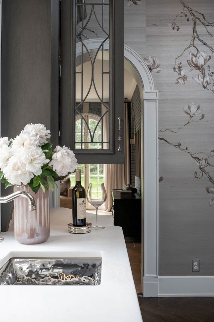 Wine bar in the corner of an elegant kitchen designed by Sunnyfields Cabinetry and DACG.