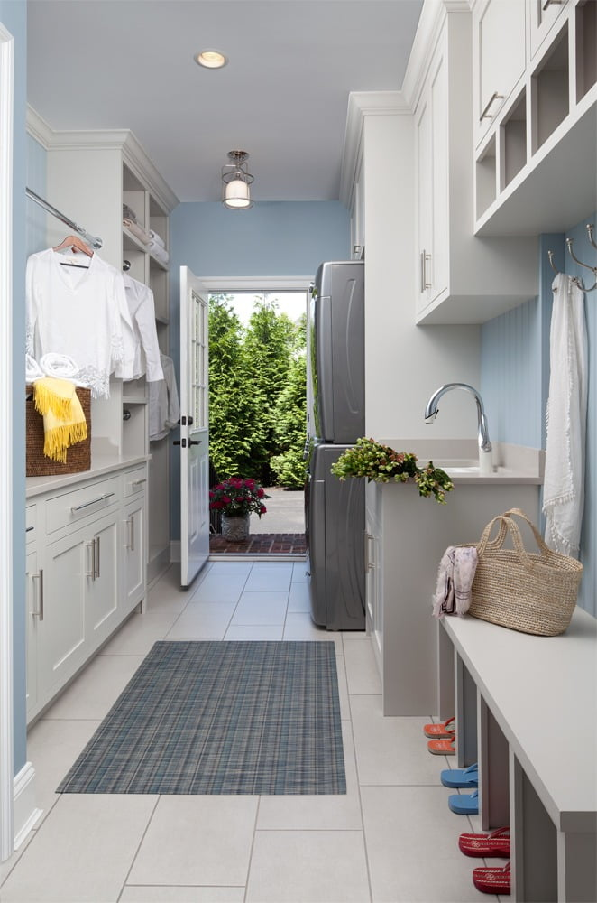 Laundry room and mudroom leading to the outside of a luxury home in Baltimore.