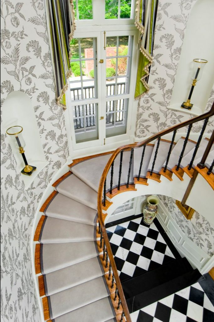 Grand staircase designed by Delbert Adams Construction Group.