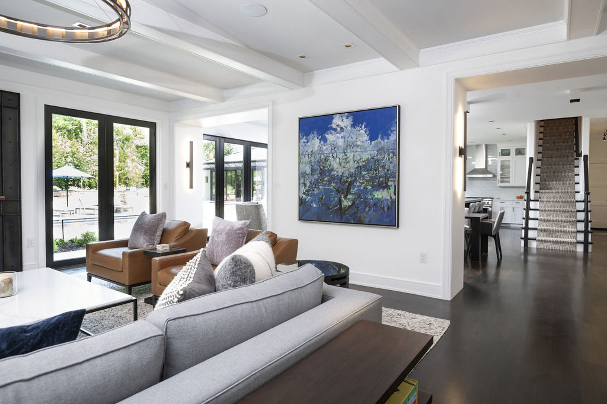 Modern family room with dark hardwood flooring and cabinetry, all white wall color (Different view)