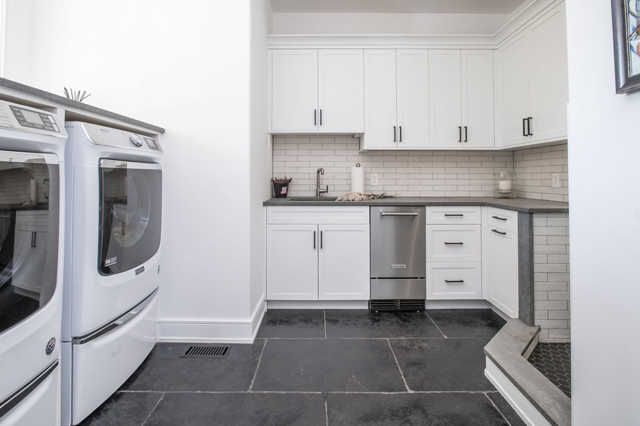 Remodeled mudroom with a kitchenette, white cabinetry, gray countertops and a small dog shower (Different view)